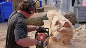 Wood carving at sculpture festival stock video footage