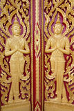 Wood carving. Temple door in Thailand Royalty Free Stock Image