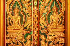 Wood carving temple door in Thailand Royalty Free Stock Photo