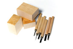 Wood carving tools with wood. Six different wood carving tools and three blocks of basswood, over white, not Stock Photo