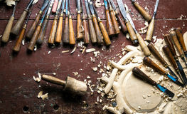 Wood carving tools on worktable Stock Photo