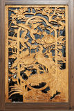 Wood carving in window Stock Image