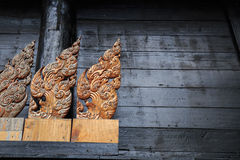 Wood carvings. On black background of Thailand Royalty Free Stock Photography