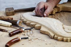 Wood carvings, tools and processes work closeup Royalty Free Stock Image