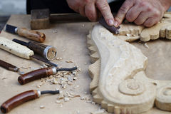 Wood carvings, tools and processes work closeup Royalty Free Stock Photos