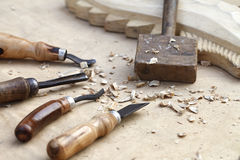 Wood carvings, tools and processes work closeup Royalty Free Stock Photo