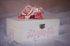 Wood casket. Decorated with roses and small flowers Stock Image