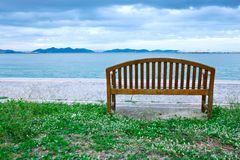 Wood chair at beach Stock Images