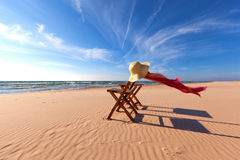 Wood Chair on Beach with Straw Hat and Scarf. Lake Stock Image