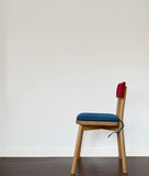 Wood Chair With Blue And Red Pad Royalty Free Stock Photo