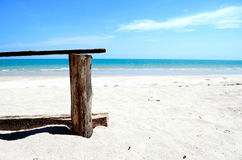 Wood Chair on the Blue Sky Beach. Wood Chair on the Blue Sky Beach in summer Stock Images