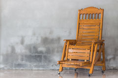 Wood chair and concrete wall. Wood vintage chair and concrete wall Stock Photo
