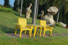 Wood Chair in garden. Yellor Wood Chair in garden Stock Image