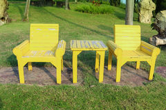 Wood Chair in garden. Yellor Wood Chair in garden Stock Images