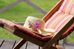 Wood chair with hat Royalty Free Stock Photo