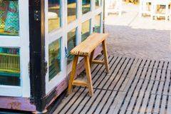Wood chair porch store front, vintage image. Wood chair porch at store front, vintage tone image Royalty Free Stock Photo
