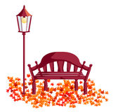 Wood chair, street lights, maple leaves Stock Photos