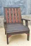 Wood chair. Chair vintage style on wood background Royalty Free Stock Photos