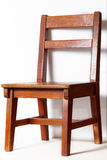 Wood chair with white wall Royalty Free Stock Image