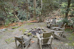 Wood chairs around fire pit Stock Photo