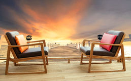 Wood chairs on home terrace against beautiful dusky sky and good Stock Photography