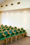 Wood chairs rows in conference hall Stock Image