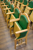 Wood chairs rows on a parquet floor. Wood folding chairs rows on a parquet floor Royalty Free Stock Photos