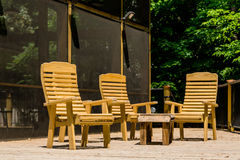 Wood Chairs on Treated Lumber Deck Royalty Free Stock Photo