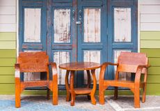 Wood chairs and wood wall Royalty Free Stock Image