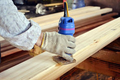 Wood check. A worker was checking a wood board in a wood manufacturer factory Stock Photo