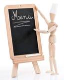 Wood chef figurine and menu Stock Image