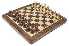 Wood chess board with white and dark chessmen. On the white surface stock image