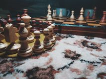 Wood chess piece on chessboard with Blurred image royalty free stock photos