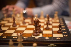 Wood chess pieces on board game. brown vintage background stock image
