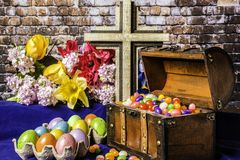 Colored Eggs Jelly Beans and Wooden Cross Royalty Free Stock Images