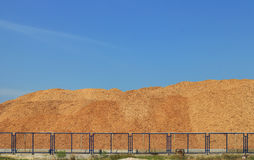 Wood Chip Mountain under Clear Sky Royalty Free Stock Image