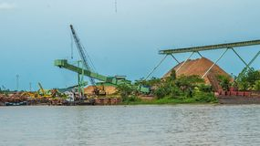 Wood chip stockpile factory on Mahakam riverbank. Industrial background royalty free stock photos