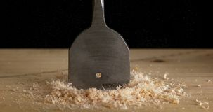 Wood Chip Turning on a Wood Board, Making Chips, Slow Motion. 4K stock footage