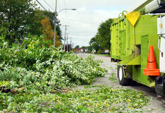 Wood chipper truck. In the street with cut down tree branches: landscape contractor stock images