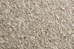 Wood chippings board as textured background Royalty Free Stock Images