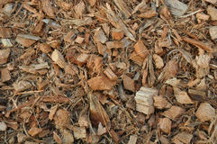 Wood chippings and coconut pieces background. Organic fertilizer stock photography
