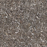 Wood chippings texture (tiled/seamless). Wood chippings texture with seamless edges for repeating and tiling Royalty Free Stock Photos
