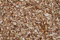 Wood Chips background. Fresh wood chips for garden, playground landscaping and background Stock Photos