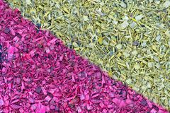 Wood chips painted in different colors as a background or textur royalty free stock photo