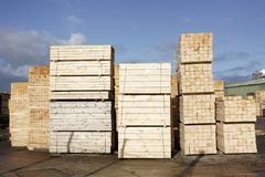 Wood chips pellets chopped wooden logs and stacked wooden pallets for biomass fuel at sawmill. Uk stock photos