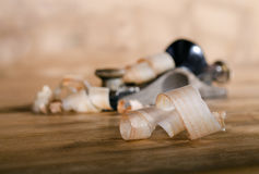 Wood chips on the table. Small chips on a wooden table the plane Royalty Free Stock Photos