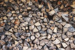 Wood chopped firewood stacked on the stack. Woodpile of cut tree Royalty Free Stock Image