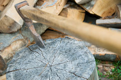 Wood chopping. Axe and a pile of already chopped lumber Stock Images