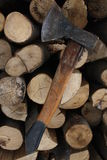 Wood chopping. Axe set on a pile of wood Royalty Free Stock Images