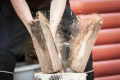 Wood chopping with hand axe. At summer cottage royalty free stock images
